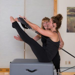 Instructor and student in a pilates class at The Sanctuary